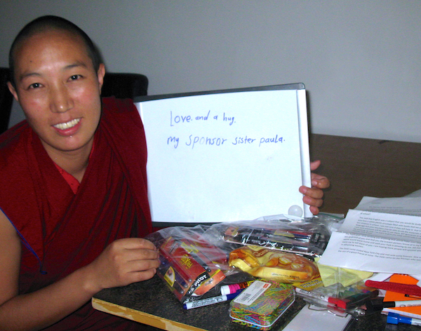 Buddhist nun holding note of thanks