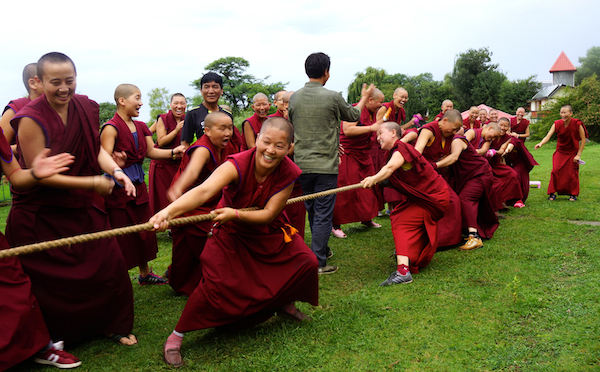 Buddhist nuns playing tug of war Dalai Lama birthday