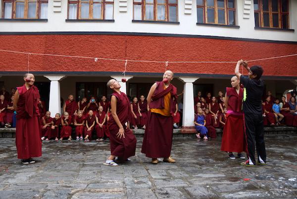 Tibetan nuns playing games on His Holiness birthday
