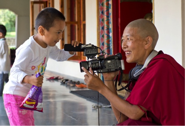 Buddhist nun making video