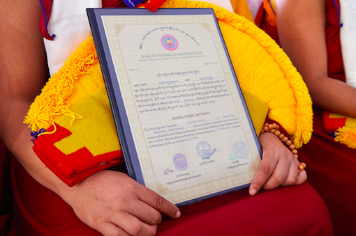 Nun holding her Geshema certificate, Geshema, Education Tibetan Buddhist nuns