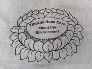 Gray Shopping Bag is made of cotton, reusable and eco-friendly with Tibetan Nuns Project screenprint on both sides, handmade by Tibetan nuns.