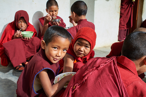 young Tibetan Buddhist nuns at Sherab Choeling Nunnery eating