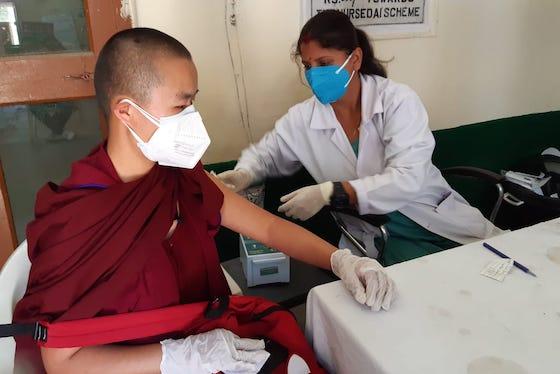 Tibetan Buddhist nun gets vaccinated for coronavirus May 2021, vaccinations, COVID-19 vaccination