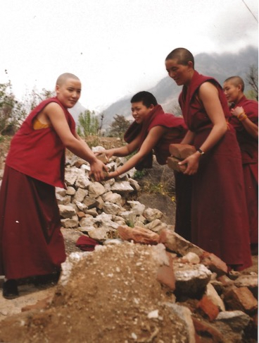 Tibetan Buddhist nuns help build Dolma Ling Nunnery and Institute