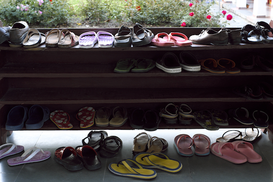 shoes outside of classroom, life during the monsoon, Tibetan nuns footwear, plastic sandals, how to cope with the monsoon, life during the monsoon