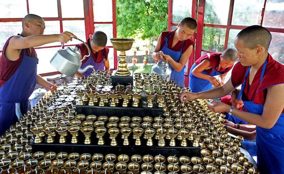 offering Tibetan butter lamps