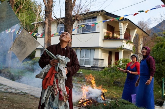 burning old Tibetan prayer flags