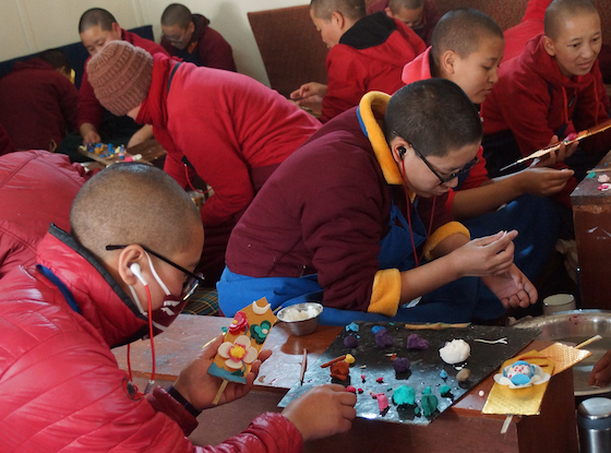 Tibetan Buddhist nuns making butter sculptures for Losar