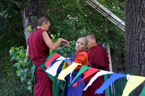 hanging prayer flags, Tibetan Buddhist holidays, Tibetan Nuns, Universal Prayer Day