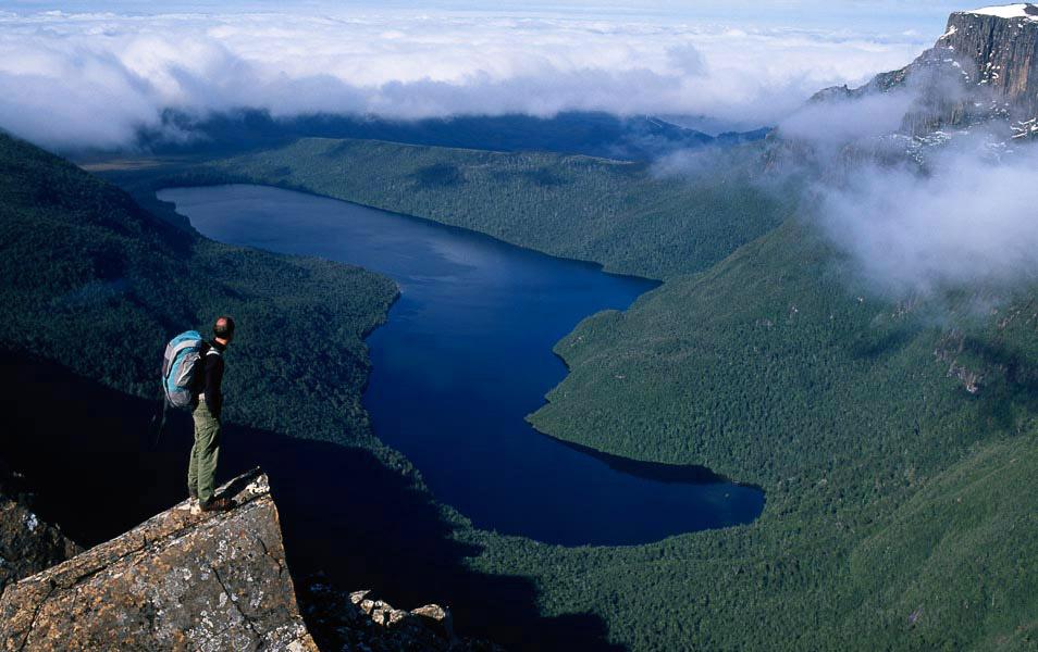 Bushwalker above Lake Judd, Southwest National Park. Photo: Grant Dixon.