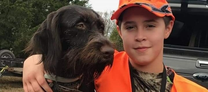 Noah Hollingsworth ready to hunt with dog.