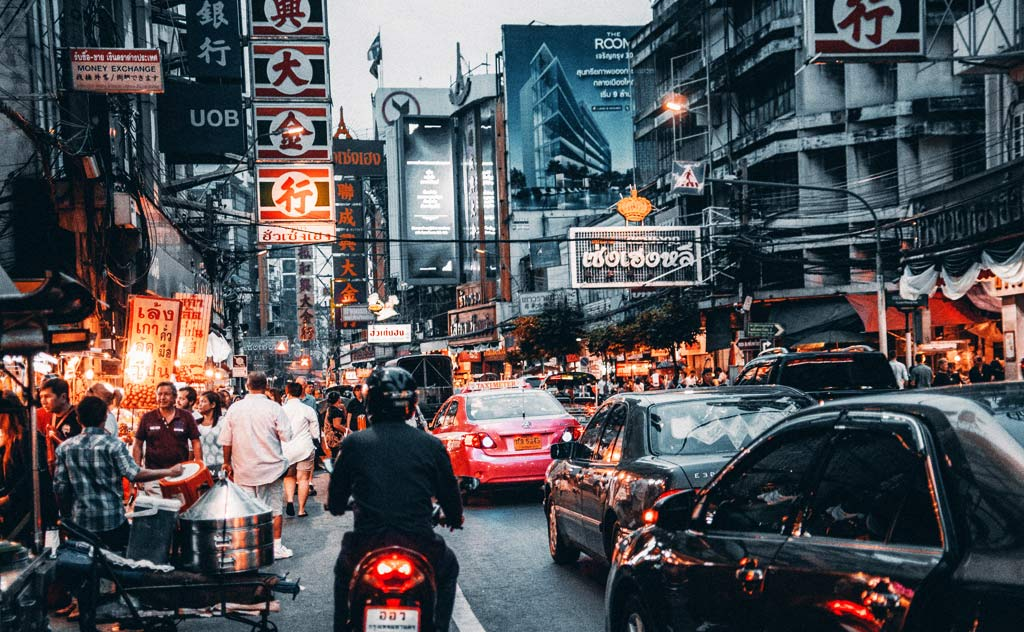 Common Scams in Thailand - How to avoid them & staying safe. Image of busy Bangkok street