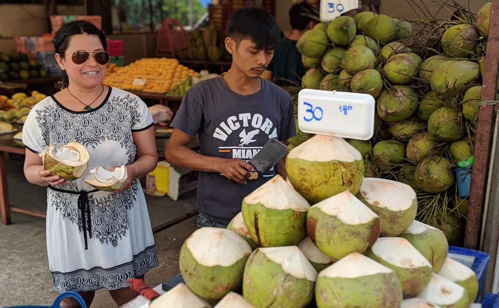 Mona enjoying a coconut in Bangkok, Thailand