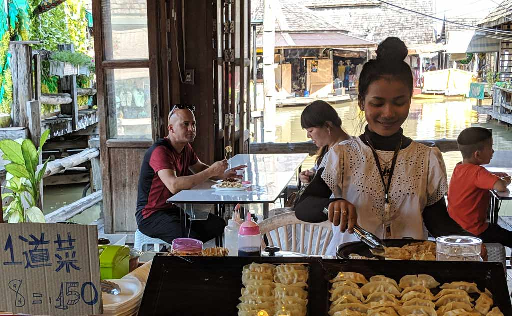 Thai lady preparing momos/dumplings in Pattaya Floating Market
