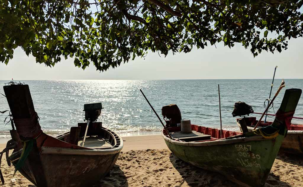 Jomtien Beach Pattaya - view of beach and boats from under a tree