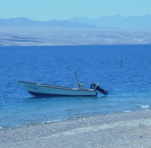 A lone boat sits in the bay of Eilat, Israel.