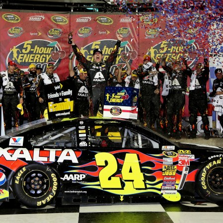 KANSAS CITY, KS - MAY 10: Jeff Gordon, driver of the #24 Axalta Coatings Chevrolet, celebrates in victory lane after winning the NASCAR Sprint Cup Series 5-Hour Energy 400 at Kansas Speedway on May 10, 2014 in Kansas City, Kansas. (Photo by Jerry Markland/Getty Images)