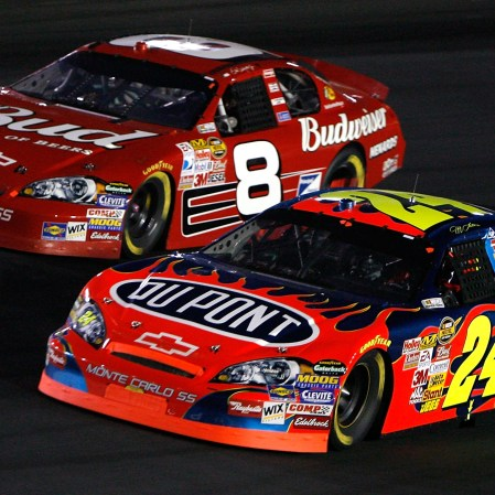 CONCORD, NC - OCTOBER 13: Dale Earnhardt Jr., driver of the #8 Budweiser Chevrolet, races Jeff Gordon, driver of the #24 DuPont Chevrolet, side by side during the NASCAR Nextel Cup Series Bank of America 500 at Lowe's Motor Speedway on October 13, 2007 in Concord, North Carolina. (Photo by Kevin C. Cox/Getty Images for NASCAR)