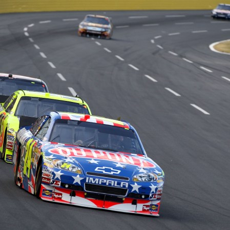 CONCORD, NC - MAY 30: Jeff Gordon, driver of the #24 DuPont Stars & Stripes Chevrolet, leads a group of cars during the NASCAR Sprint Cup Series Coca-Cola 600 at Charlotte Motor Speedway on May 30, 2010 in Concord, North Carolina. (Photo by Streeter Lecka/Getty Images)