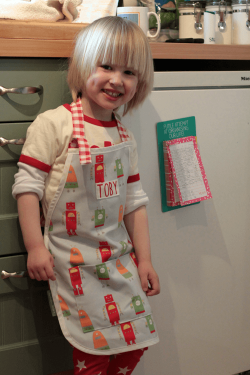 All done and loving his robot apron
