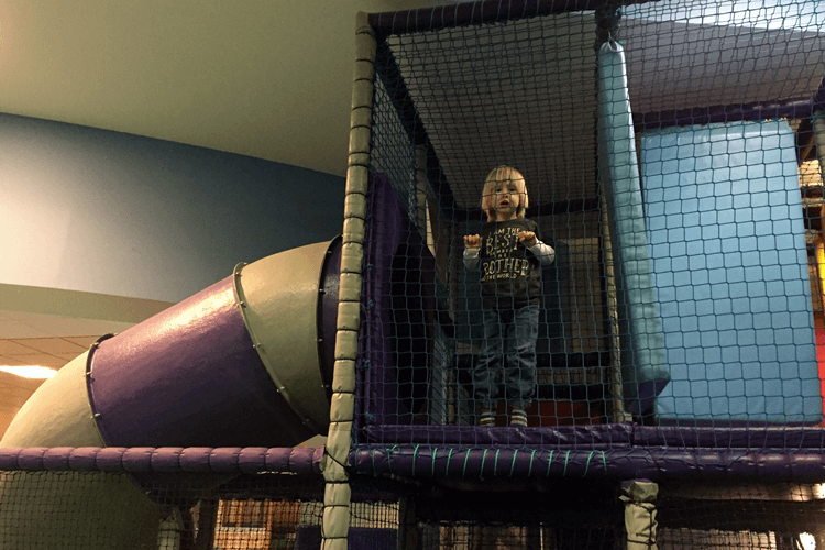 Toby exploring the big kids soft play