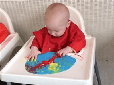 Gabe painting at nursery