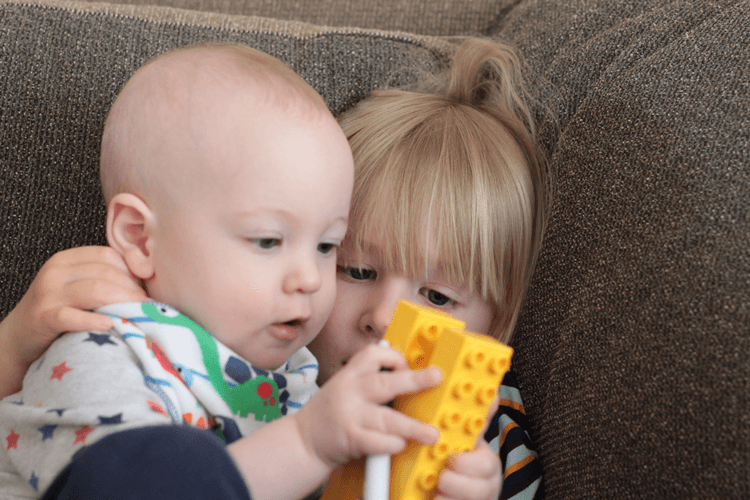 Toby and Gabe playing with Duplo