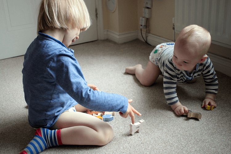 Siblings almost playing together