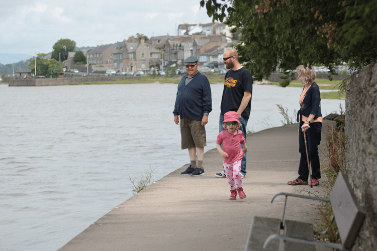 toby-with-his-dad-and-grandparents-looking-back-towards-arnside