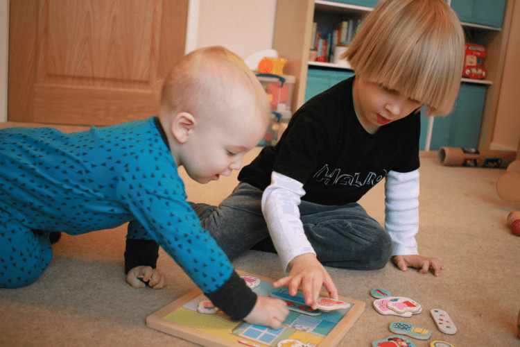 Toby and Gabe playing together with a puzzle