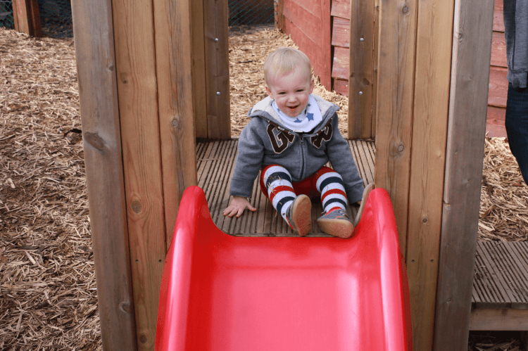 Gabe getting the hang of the slide