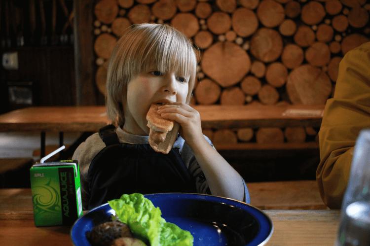 Toby enjoying a hot dog at Camp Smokey