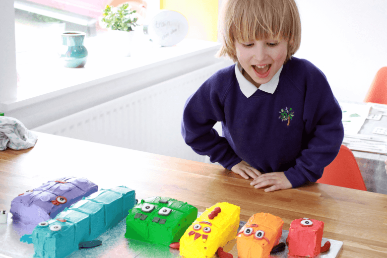 Toby seeing his Numberblocks birthday cake for the first time