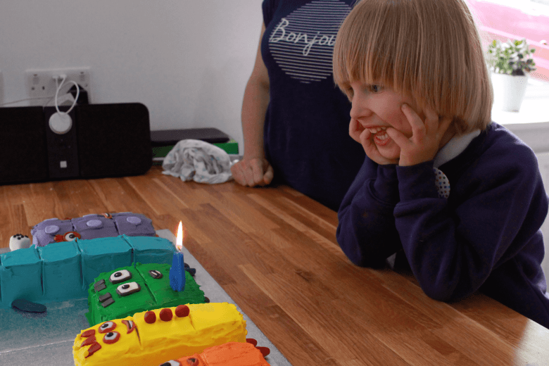 Toby about to blow out the candle on his Numberblocks cake