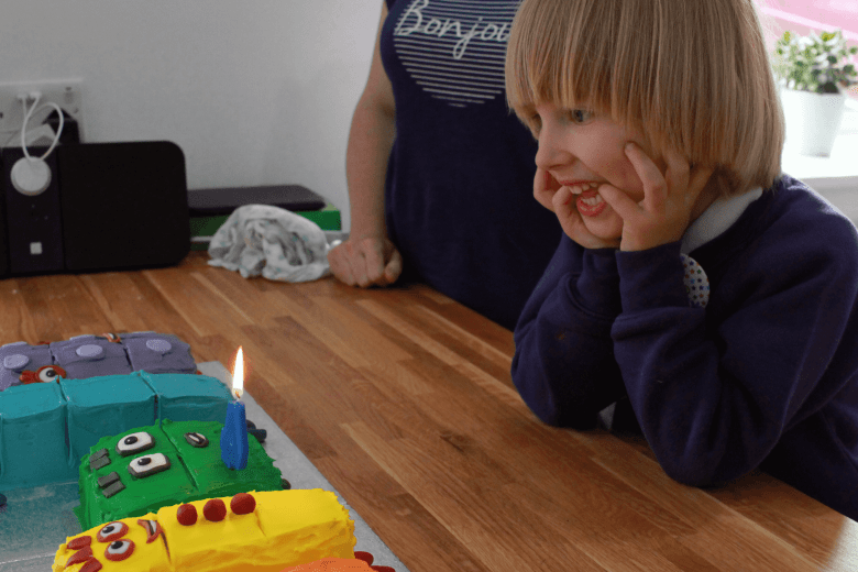 Toby ready to blow out the candle on his Numberblocks cake