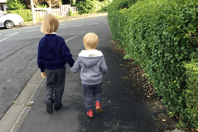 Toby and Gabe - siblings walking home from school together