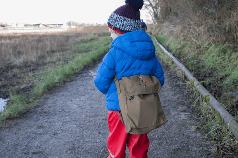 Toby enjoying a winter walk with his Dinosaur Hunting Kit