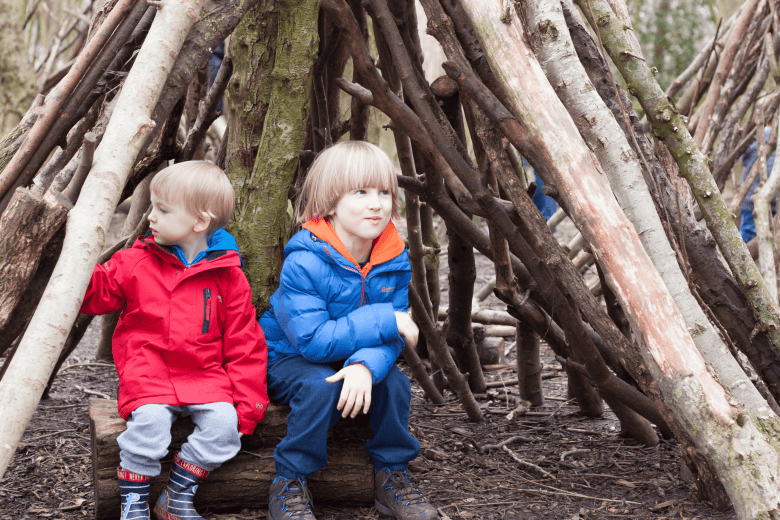 Toby and Gabe in a wood shelter - Siblings March 2018