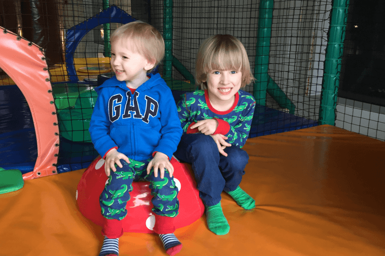 Siblings in soft play wearing matching Maxomorra