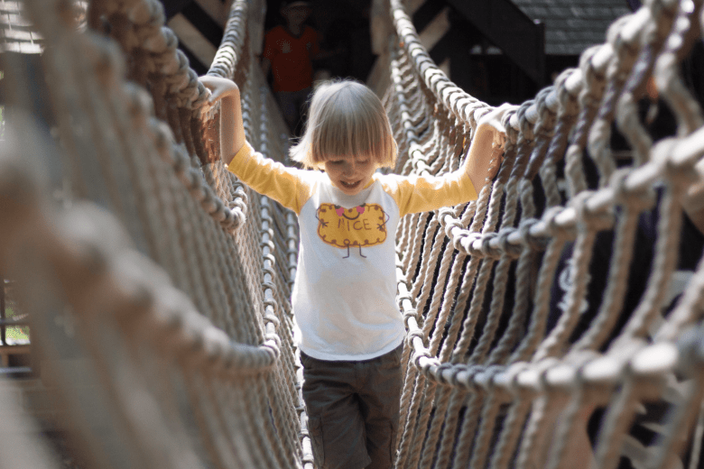 Toby crossing a rope bridge in the play area at Salmesbury Hall
