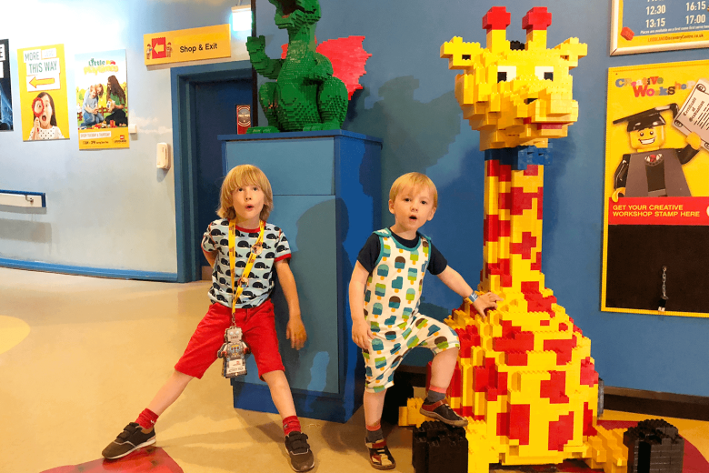 Brothers enjoying a trip to Legoland Discovery, Manchester