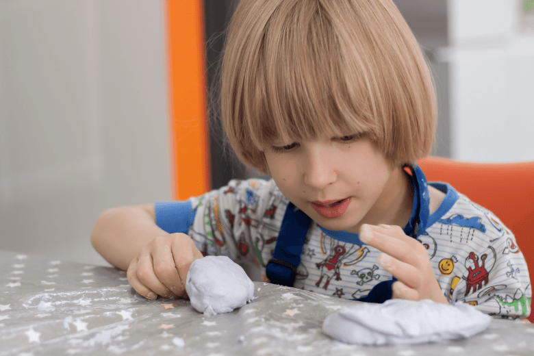 Toby playing with our homemade cloud dough