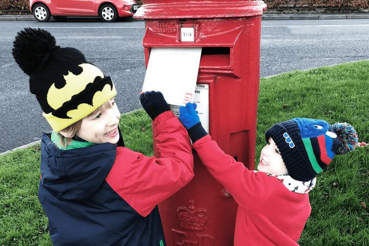 Brothers posting their letter to Father Christmas