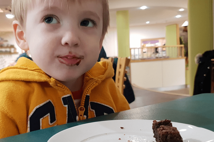 Gabe enjoying chocolate cake