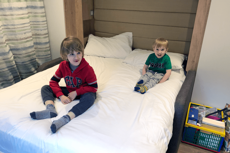 oby and Gabe on mummy and daddy's bed in the glamping pod
