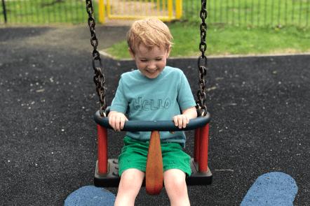 A very sweaty Gabe on the swing