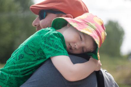 Gabe sleeping on Daddy's shoulder
