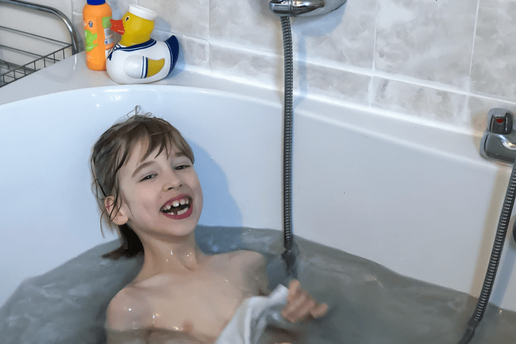 Toby lying back in the bath
