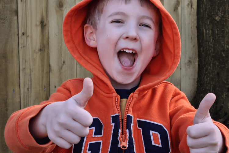 Gabe with his thumbs up and a big grin